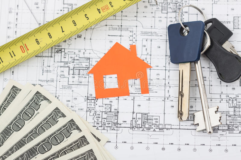 Model house on construction plan. For house building, keys and clipboard. Real Estate Concept royalty free stock photo