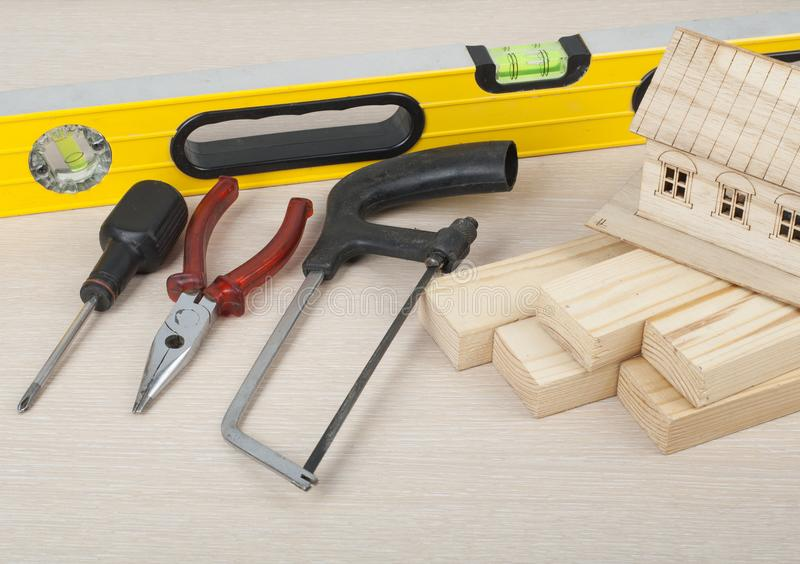 Construction concept. Model house and tools on wooden table.Copy space for text. royalty free stock images