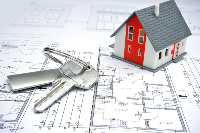 Model of a house and key ring. On a blueprint royalty free stock photo