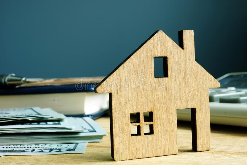 Model of house and money. Buy property or mortgage. Concept stock images