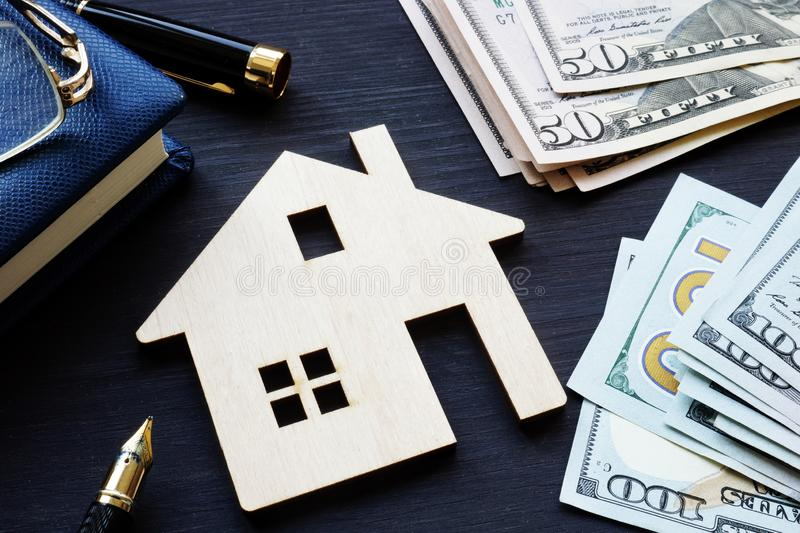 Model of house and money. Real estate investment. Model of house and money. Real estate investment concept stock photo