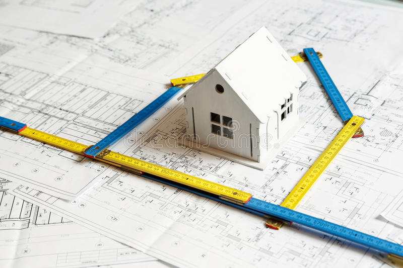 Model of a house on top of blueprints and architect tools stock download model of a house on top of blueprints and architect tools stock image image malvernweather Gallery