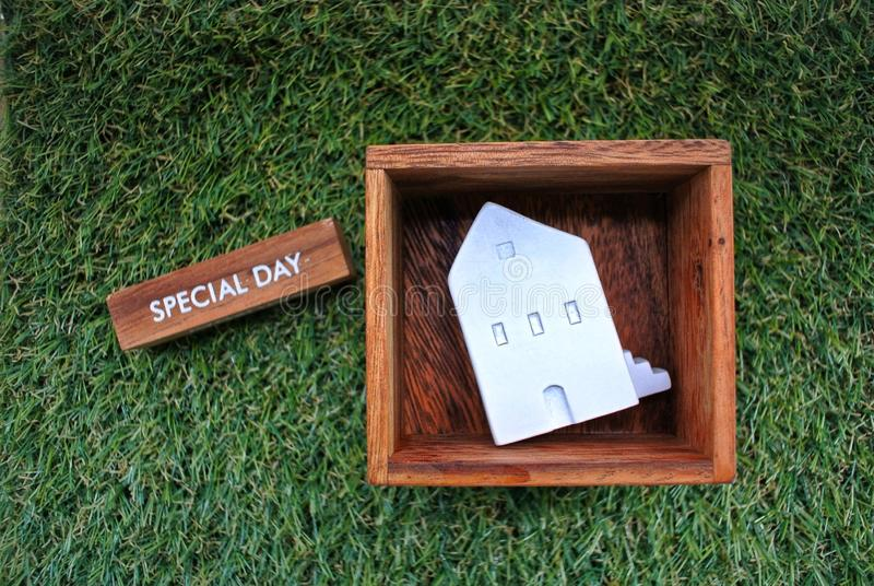 Model house and a wooden box labeled Special Day on the grass background.Finance and Home Loan Concept. Backgroundfinance royalty free stock photos