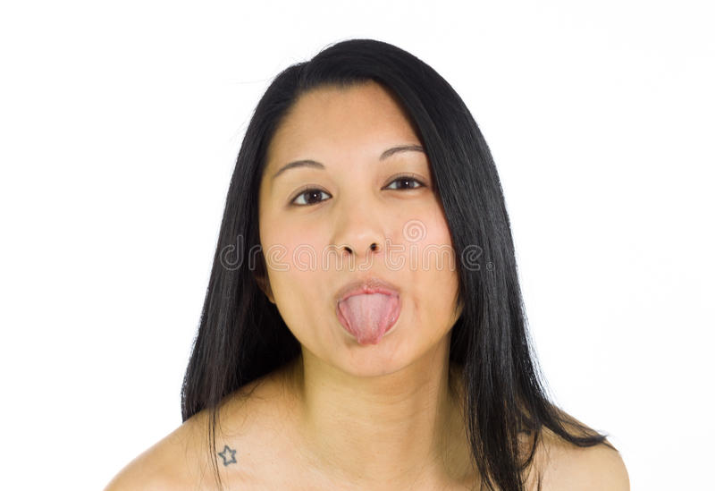 Model isolated sticking tongue out royalty free stock photography