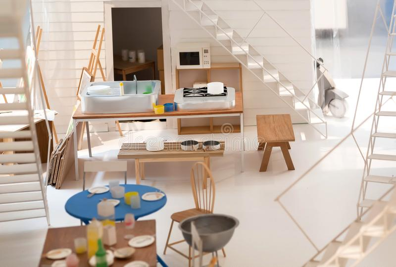 Model of kitchen in simple apartment, paper and cardboard layout. Furniture and decors, ideas of interior design stock photos