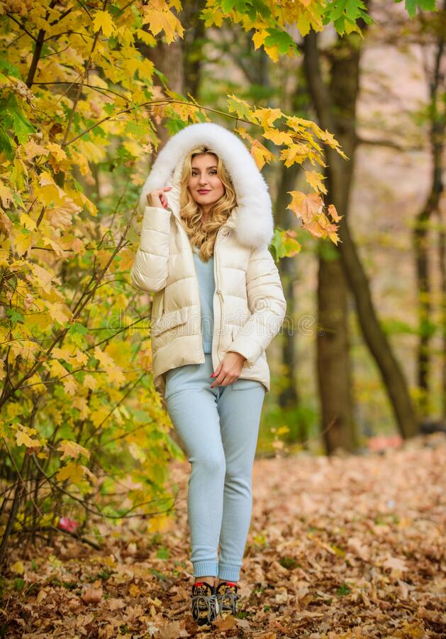 Model knitwear clothes leaves background. Feel practicality and comfort. Clothes for rest. Woman enjoy autumn season in. Park. Warm knitwear. Girl relaxing in stock photo