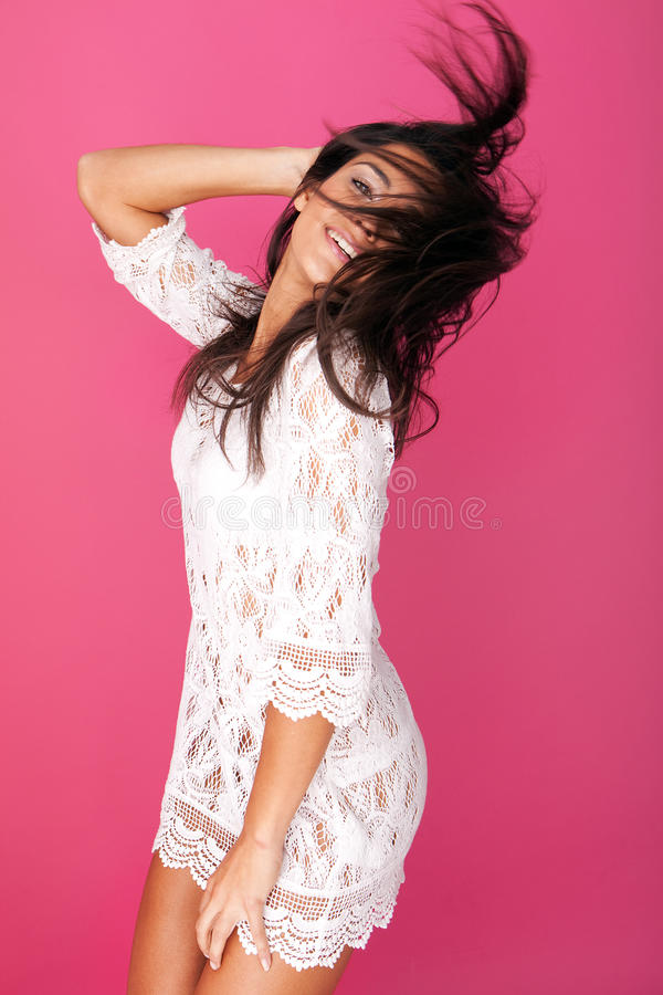 Model In Lacy Garment Flicking Hair stock image