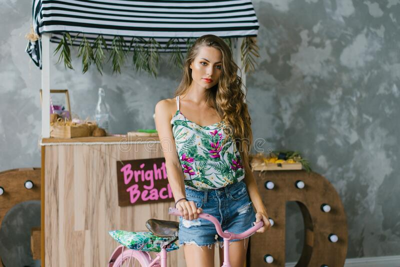 Model-like appearance of a young woman dressed in summer tropical clothes royalty free stock image