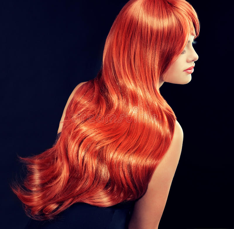 Model with long curly red hair stock images