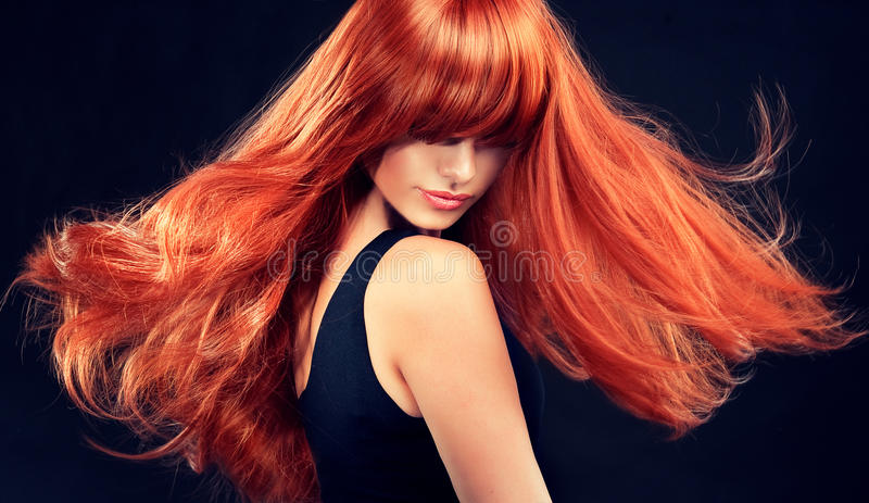 Model with long curly red hair stock image