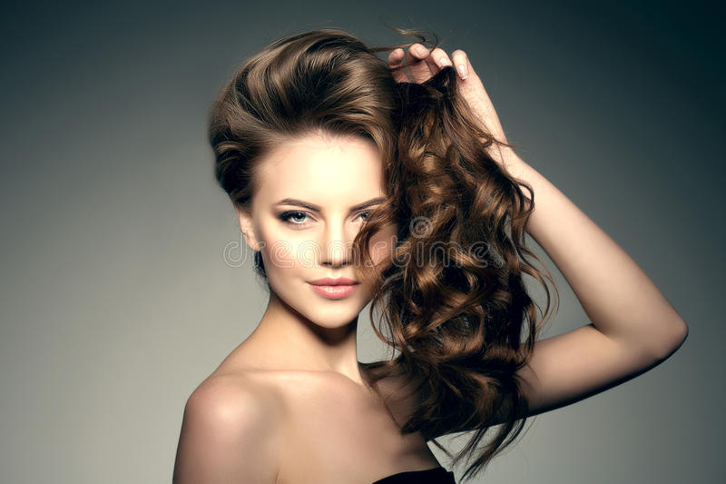 Model with long hair. Waves Curls Hairstyle. Hair Salon. Updo. F stock image