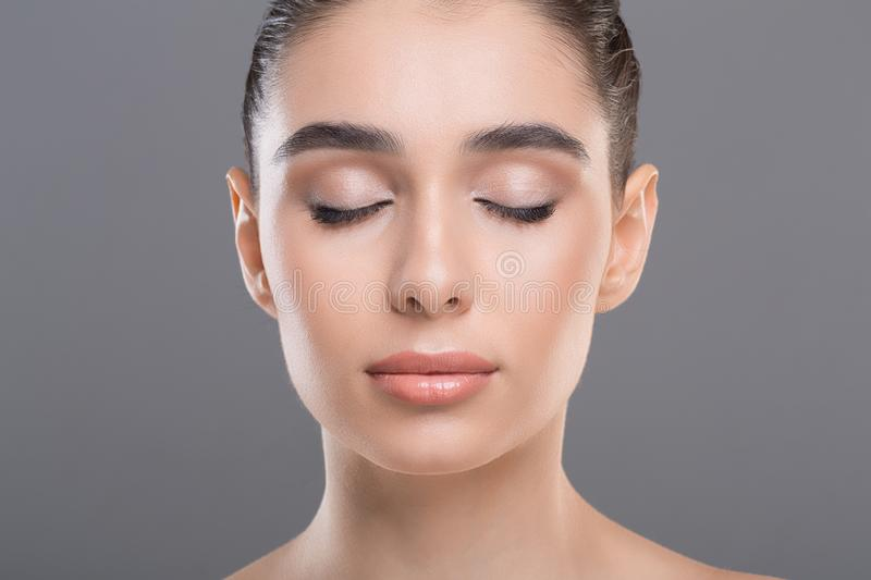 Portrait of beautiful woman with clean skin and closed eyes. Model for makeup artist. Portrait of beautiful woman with clean skin and closed eyes, close up royalty free stock photo