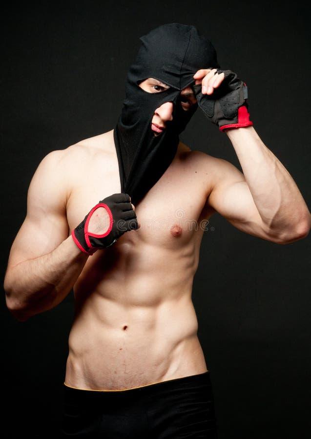 Model in masker stock afbeelding