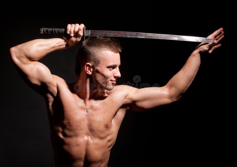 Model met zwaard stock afbeeldingen