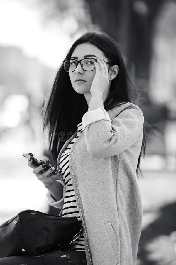 Model in the middle of city with phone stock image