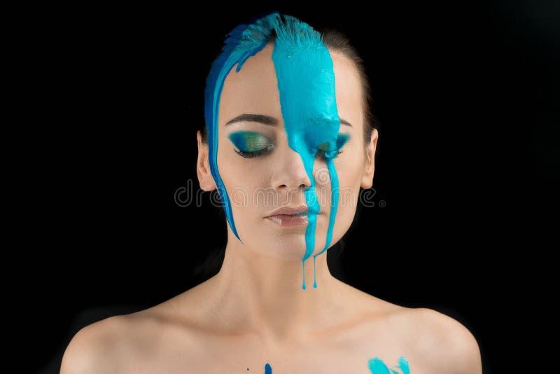 Model paint on the face. Blue makeup. creative makeup stock photos
