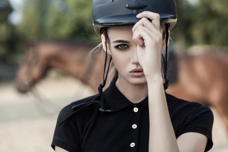 Model with perfect makeup holds a helmet with one hand stock images