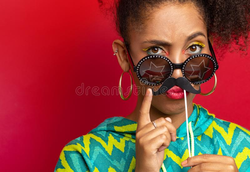Model plays with cardboard mustache royalty free stock images