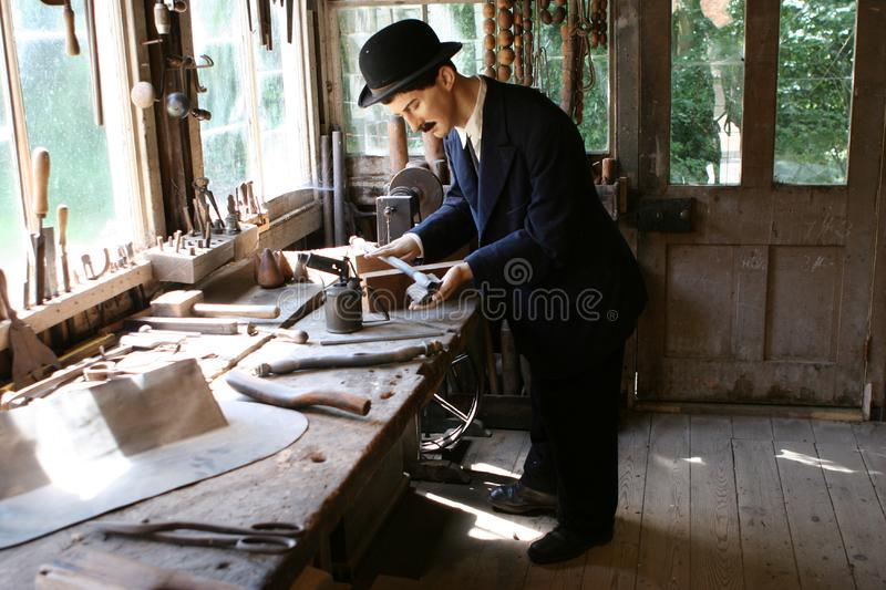 Model Plumber in his Workshop stock photo