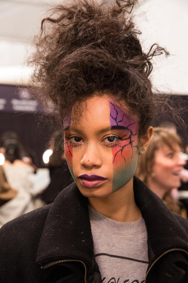 A model posing backstage at the FTL Moda fashion show during MBFW Fall 2015. NEW YORK, NY - FEBRUARY 15: A model posing backstage at the FTL Moda fashion show royalty free stock photography