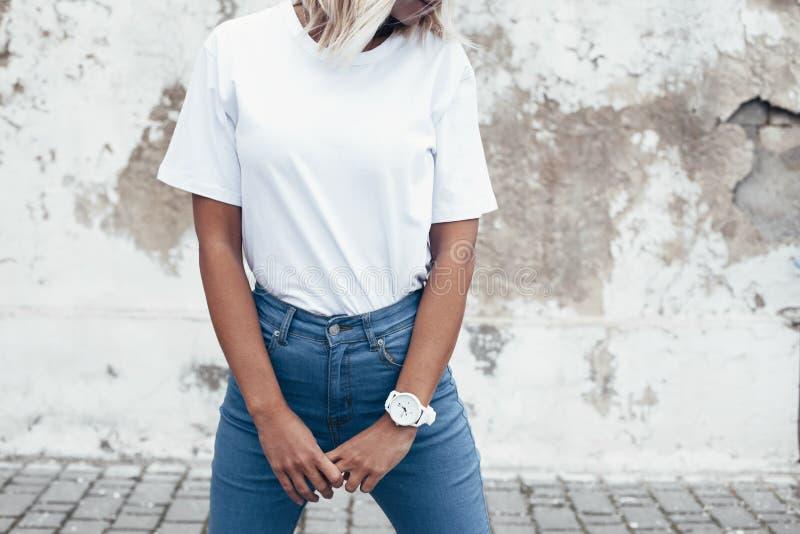 Model posing in plain tshirt against street wall stock for Plain t shirt model