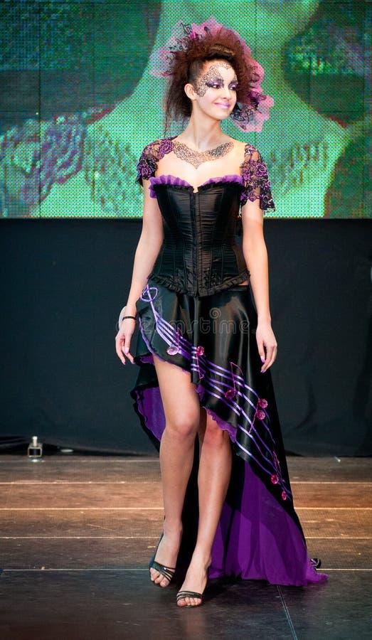 Model in purple walks the runway during stock photo