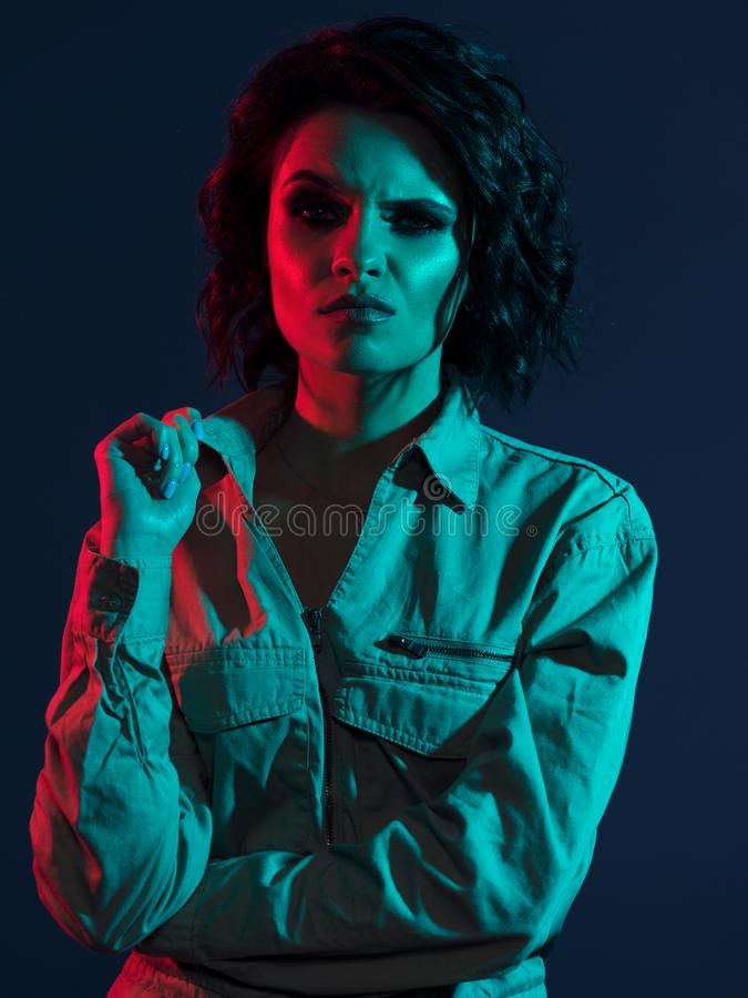 Disgust or bewilderment emotion, female neon studio portrait stock photo