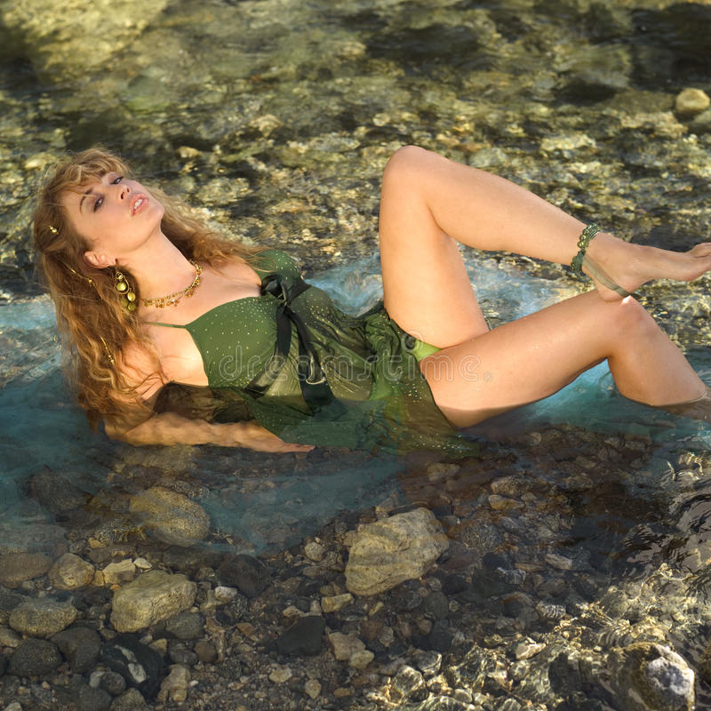 Free Model Reclining In Mountain Stream Royalty Free Stock Photography - 14666307