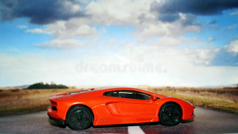 Model of red car on hot asphalt. royalty free stock photography