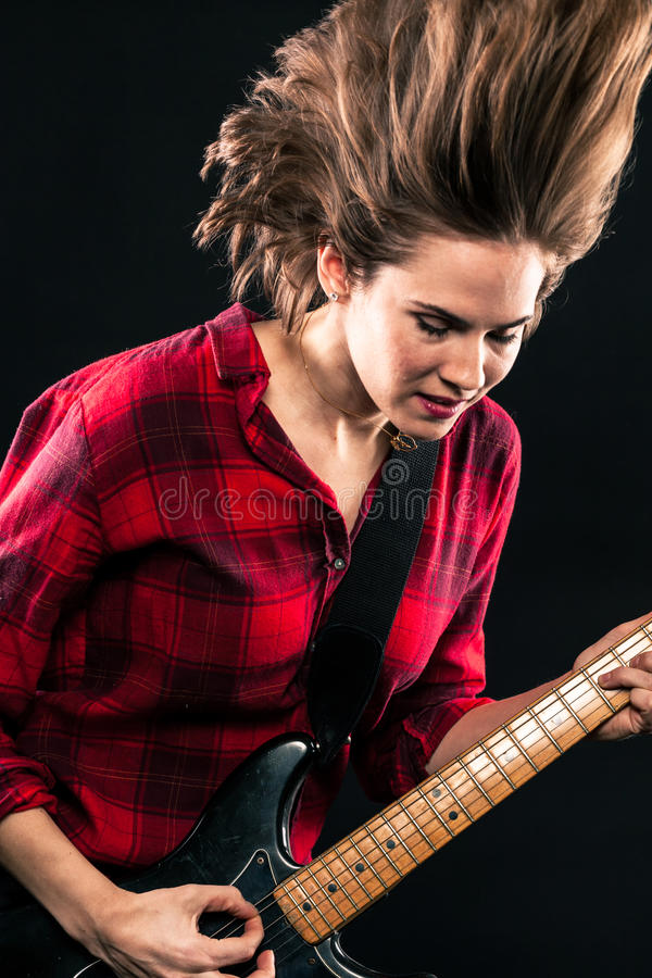 Model Red Flannel Shirt Crazy Hair Guitar. Model Red Flannel Shirt Crazy Hair In Air Guitar royalty free stock photo