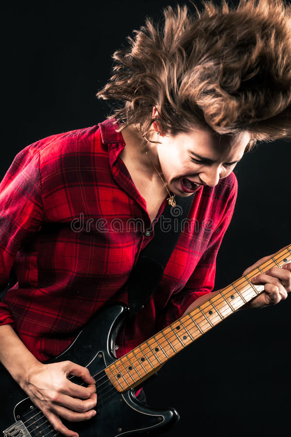 Model Red Flannel Shirt Electric Guitar Hair Flip. Screaming royalty free stock image