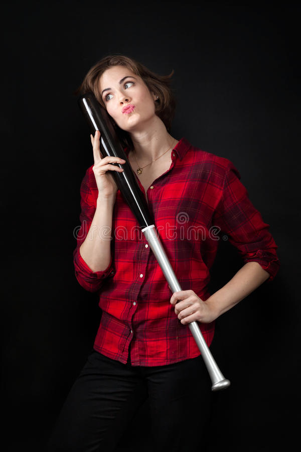 Model Red Flannel Shirt Hugging and Kissing Baseball Bat. Model Red Flannel Shirt Hugging Baseball Bat stock image