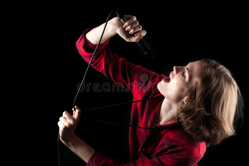 Model Red Flannel Shirt Looking Up Singing. Into microphone stock photos
