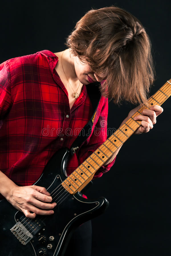 Model Red Flannel Shirt Rocking Guitar. Looking Down stock photos