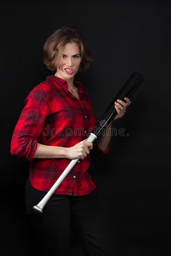 Model Red Flannel Shirt Scowling with Bat. Looking Tough royalty free stock images