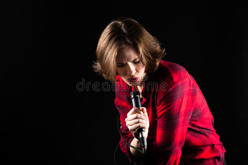 Model Red Flannel Shirt Singing Down. Into Mic stock images