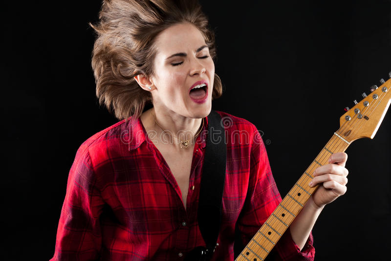 Model Red Flannel Shirt Singing & Electric Guitar. Concentrating stock photo