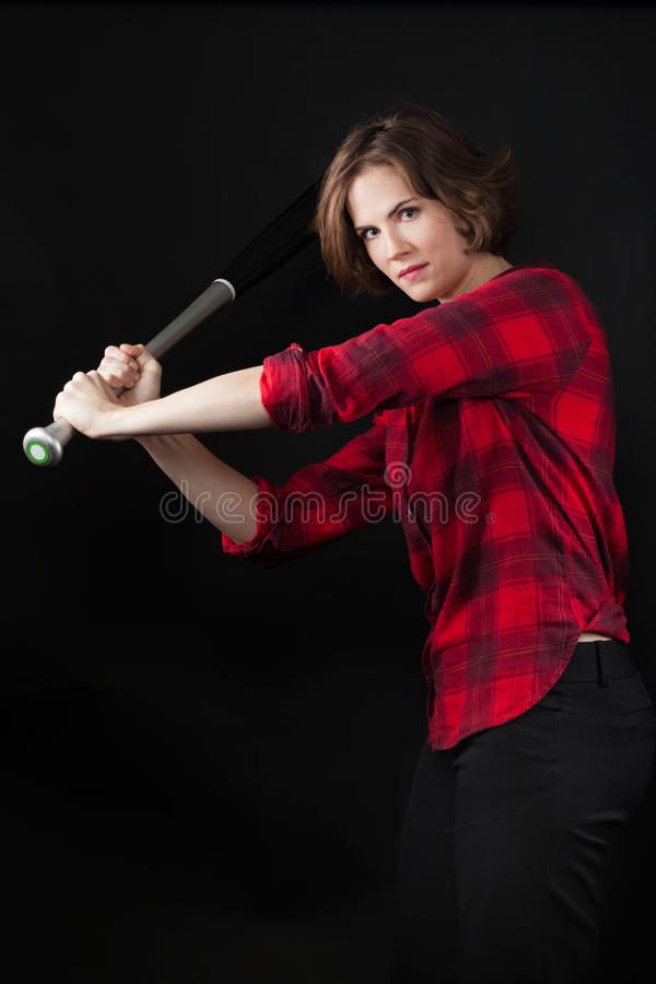 Model Red Flannel Shirt Swinging Baseball Bat. To Side stock photo