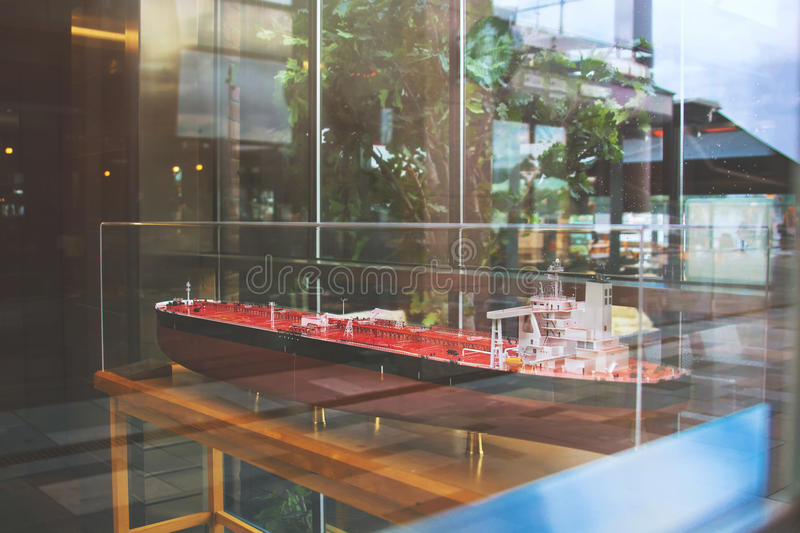 A model of red oil tanker ship in the showcase stock photography