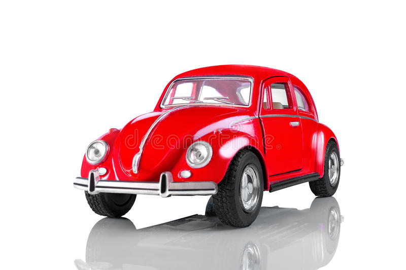 Model of the red toy car. The isolated object on a white background with reflection. One object. The object is made of metal, plastic, rubber. It is located on royalty free stock image