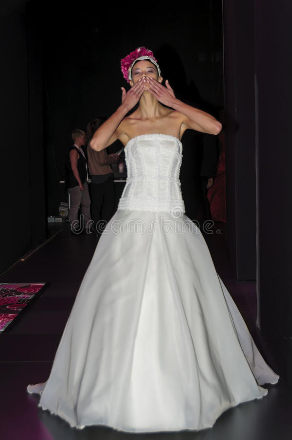 Model returning from catwalk blowing a kiss stock photo