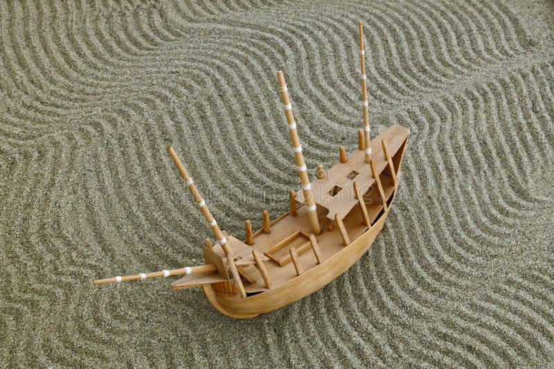 Model ship on the sand royalty free stock photography