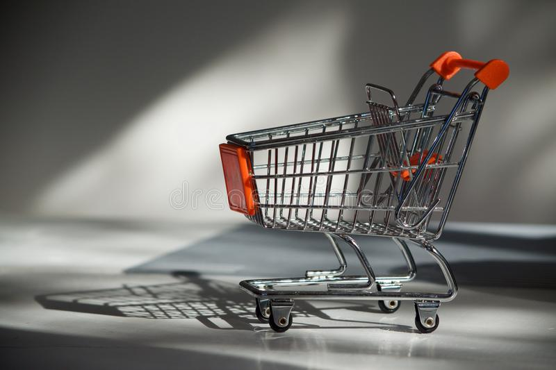 Model shopping cart shadows stock images