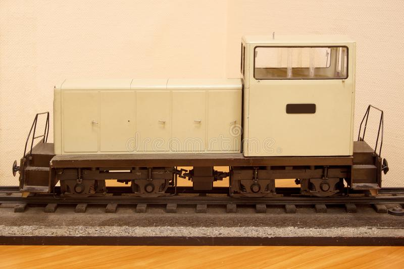 Model of a shunting diesel locomotive.Toy railroad. Carefree childhood stock image