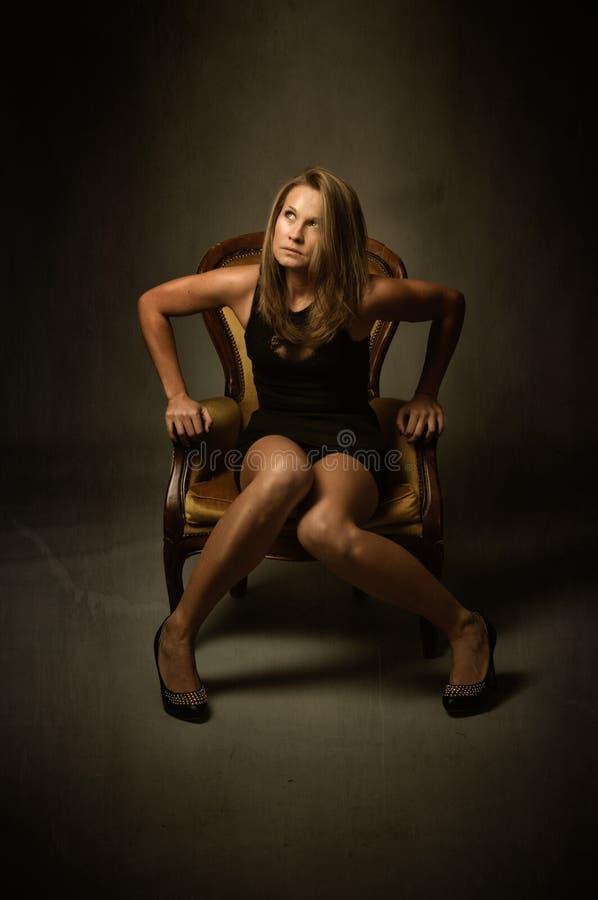 Model sit on yellow sofa royalty free stock photos