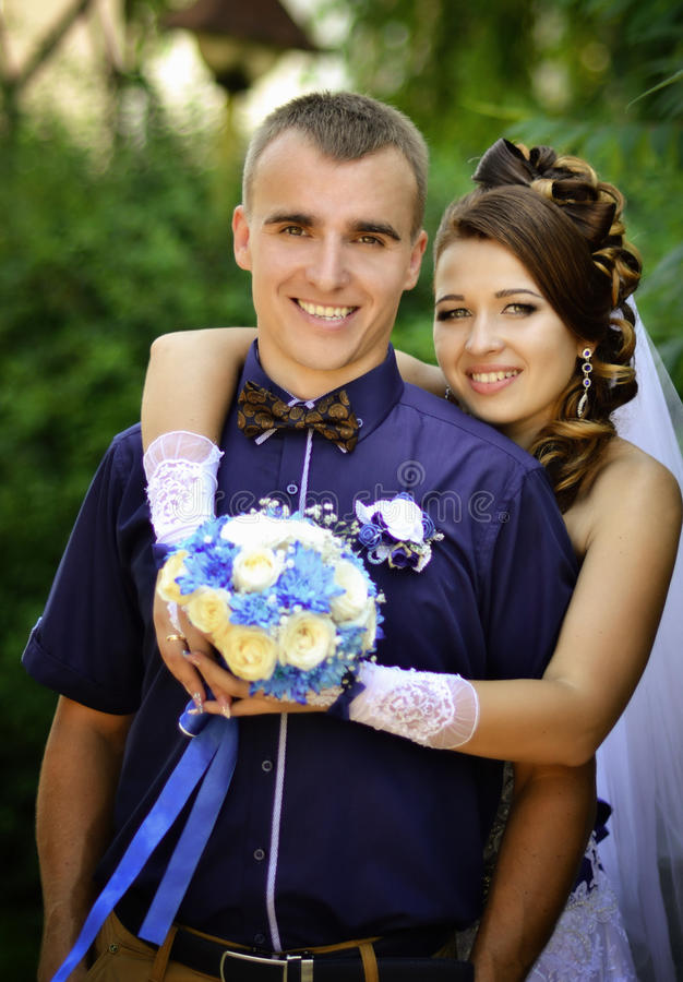 Happy,smiling,new young family on wedding day.Wedding love stock photography