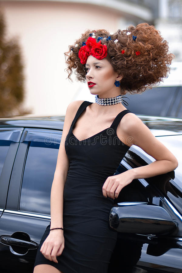 Seductive,attractive,professional,fashionable model with creative hairstyle stand outdoors stock images