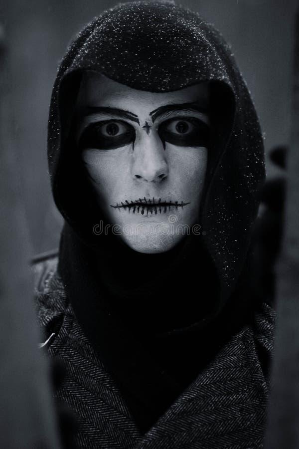 Nightmare, your eternal horror, reduction, dark ominous demon, devil. Halloween.Mystical, interesting, handsome guy in black, whit stock image