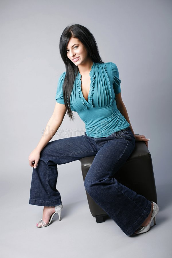 Model Sitting On Ottoman Royalty Free Stock Photography
