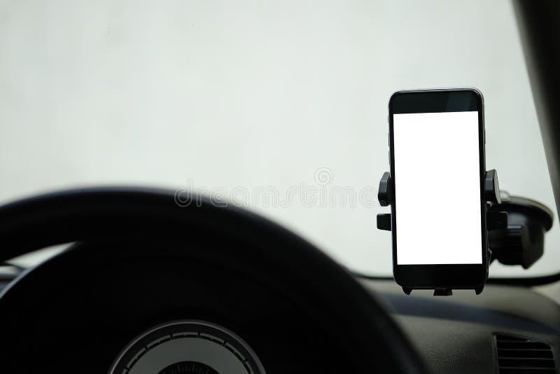 Model Smartphone in een autogebruik voor Navigate of GPS Smartphone i stock afbeeldingen